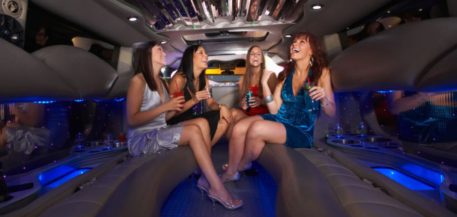 Luxury Limo photo - four women in back seat of a limo